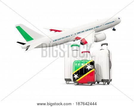 Luggage With Flag Of Saint Kitts And Nevis. Three Bags With Airplane