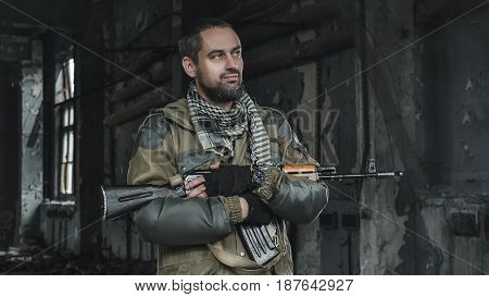 photo of man in uniform with a weapon