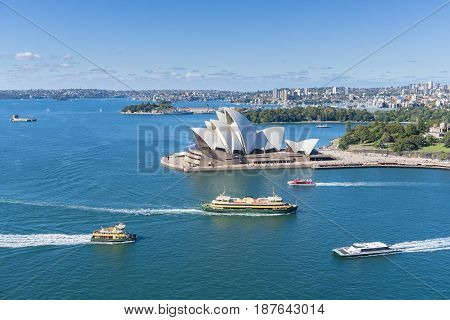 Sydney, Australia - May 16, 2017: View of Sydney Opera House with ferries passing by. It is the most popular travel destination in Sydney.