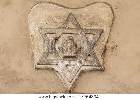 Star of David -relief on facade of Old New Synagogue JosefovJewish quarter of Prague Czech Republic. Built in the 13th century is Europe's oldest active synagogue
