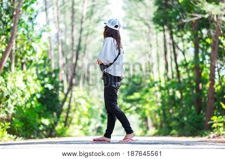 Asia Woman Wearing Casual Wear Walking On Walkway In Green Forest For Looking Scenery View Have Natu