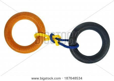 Wooden puzzle with rings  isolated  on white background