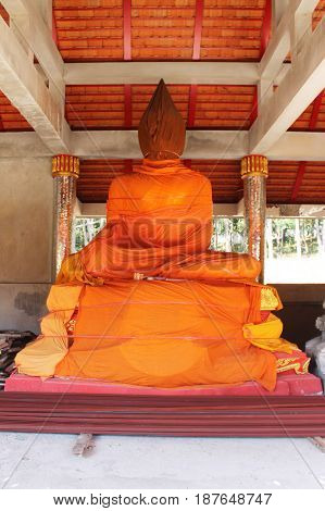 photo of buddha statue wrapped by yellow robe
