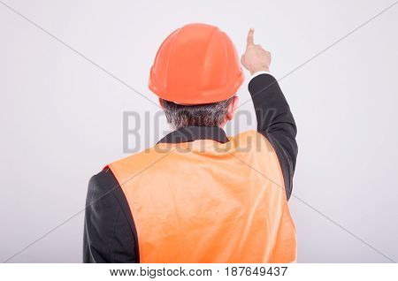 Back View Of Engineer Pointing Something