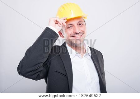 Portrait Of Foreman Smiling Holding His Hardhat