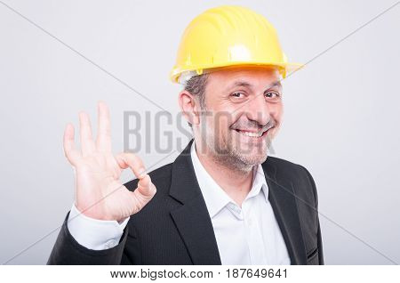 Contractor Wearing Hardhat Making Ok Gesture