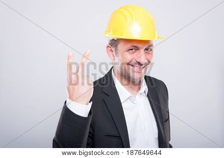 Portrait Of Handsome Engineer Showing Number Two Gesture