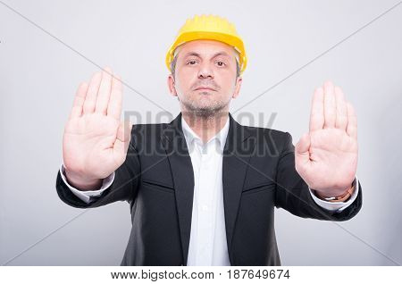 Attractive Contractor Wearing Helmet Gesturing Stop