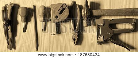 Working tools on wooden background. The manufacture of furniture.
