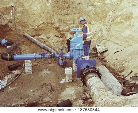 Worker Underground On Gate Valve, Reconstrucion Of Drink Water System