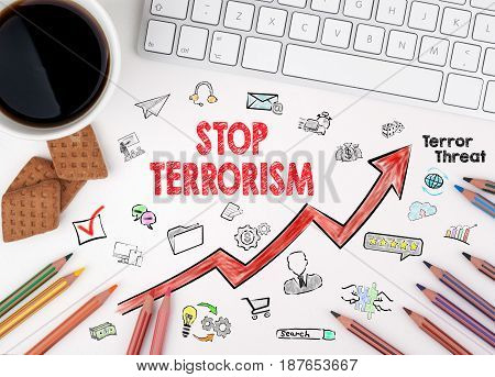 Stop terrorism Concept. Computer keyboard and cup of coffee on a white table.