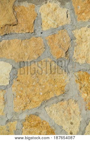 Stone wall pattern. Close up of big concrete bricks outside.