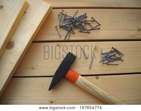 Hammer, nails and boards  for DIY on a wooden background