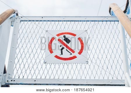 No entry sign on cruise ship. The sign is a universal red colored round circle with a person inside.
