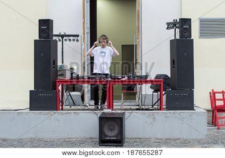 NIZHNY NOVGOROD, RUSSIA  May 20, 2017: Night of museums festival.Young disc jockey is ready to hold a disco at Arsenal Museum, Kremlin. NIZHNY NOVGOROD