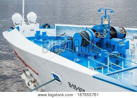 Bow of a ferry ship with ropes, anchor