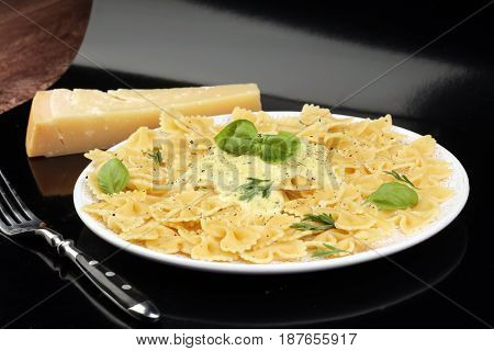Delicious Creamy Italian Penne Pasta Starter With Pepper Seasoning And Fresh Basil Viewed From Above