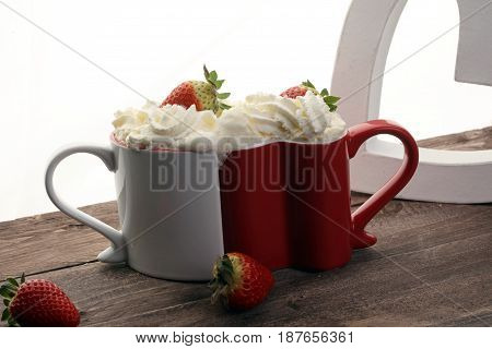 Valentine's Day Concept With Hearts And Cups. Coffee Or Hot Chocolate With Whipped Cream