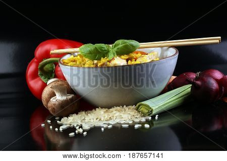 Homemade Chinese Fried Rice With Vegetables, Chicken And Fried Eggs Served On A Plate With Chopstick