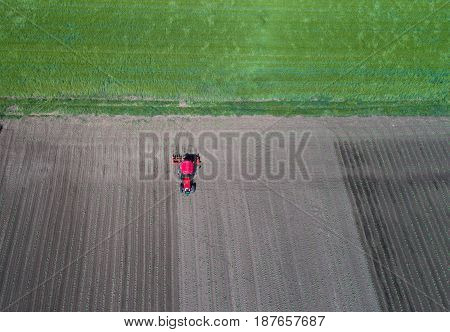 Tractor Working In Field In Spring