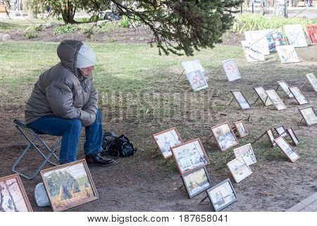 Veliky Novgorod, Russia - 13 May:the Woman Sells Pictures At Kremlin Walls , Russia - 13 May 2017.