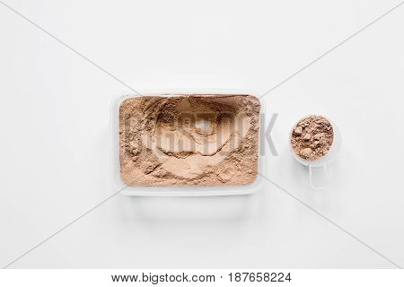 nutrition for workout with protein cocktail powder on white table background top view