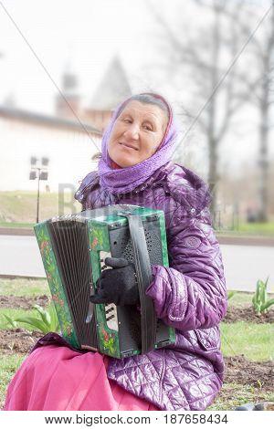 Veliky Novgorod, Russia - 13 May:the Woman Plays A Bayan At Kremlin Walls , Russia - 13 May 2017.