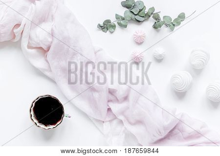 woman lunch with marsh-mallow and flowers trendy design in soft light on white table background flat lay