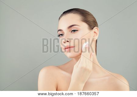 Skin Care and Facial Treatment Concept. Young Healthy Woman with Beautiful Clear Skin Holding Cotton Pads on Banner Background with Copy Space