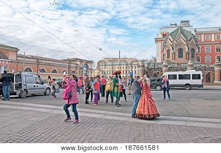 SAINT - PETERSBURG, RUSSIA - MAY 18, 2017: People take pictures on the square near The Church of the Resurrection (Savior on the Spilled Blood). On the background is Museum of Stone