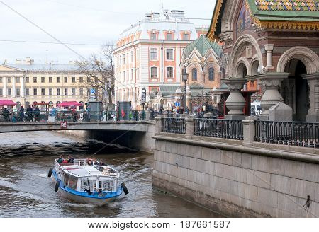 SAINT - PETERSBURG, RUSSIA - MAY 18, 2017: People in the boat near The Church of the Resurrection (Savior on the Spilled Blood) on Griboyedov Channel