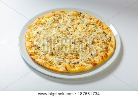 Italian Delicious Pizza With Cheese On A White Plate