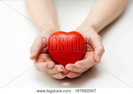 heart care health insurance or giving love concept