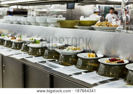Plates of food being prepared in a commercial kitchen
