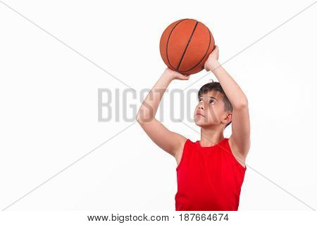 Young boy looking up and preparing to throw the ball.