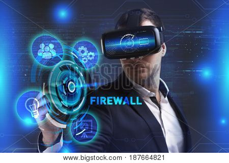 Business Technology Internet and network concept. Young businessman working in virtual reality glasses sees the inscription: Firewall
