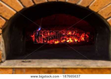 Fire and burn coals in stone ovens. Oven made of brick and clay on the wood. Oven for pizza. Brick oven.