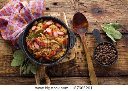Cabbage braised with sausages sauerkraut. German cuisine.