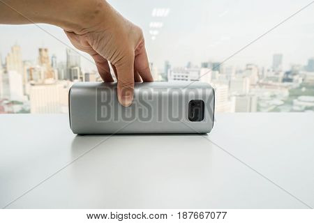 close up women hold portable wireless bluetooth speaker