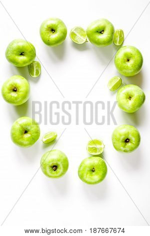 Organic fruits with green apples mock up on white desk background top view