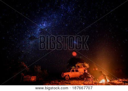 Camping With Campfire And Stars.