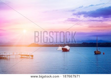 Evening lake with boats and coastline in Puerto Varas