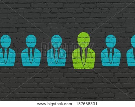 Business concept: row of Painted blue business man icons around green business man icon on Black Brick wall background