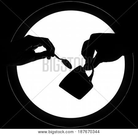 Hands giving spoon cup two fingers isolated over white round background.