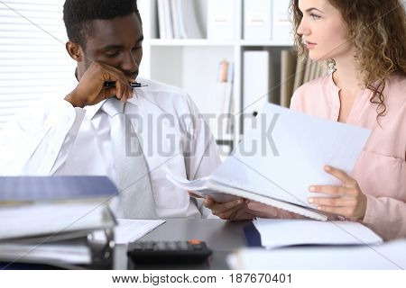 African american businessman at meeting in office, colored in white. Negotiation or hard decision concept.