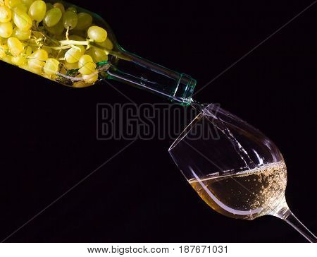 White Grape In Bottle And Glass Of Wine