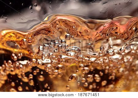 Abstract Splashes Of White Wine On A Black Background