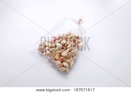 Garlic in Plastic Clear Bags Isolated on White Background