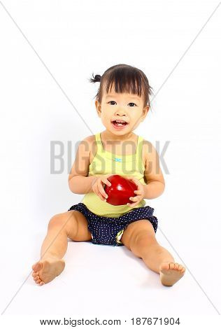 Cute asian baby with red apple (eating healthy food)