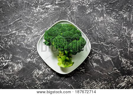 healthy green food with fresh vegetables on dark kitchen table background top view
